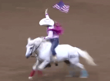 barrel racer holding flag