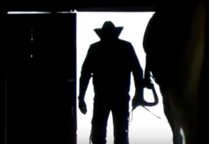 cowboy in shadows